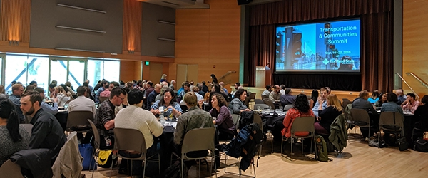 A view of the ballroom with attendees eating lunch during the Summit keynote