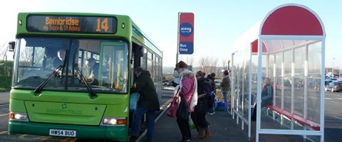 People board a bus